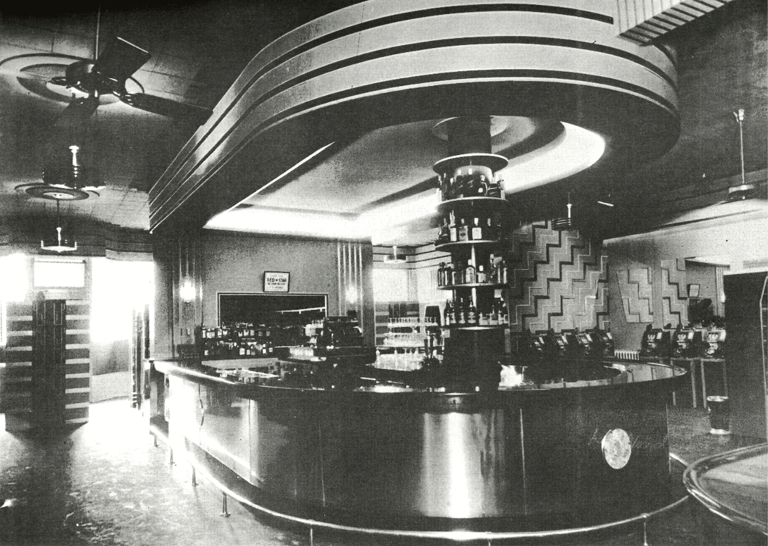 Interior vintage photo of the stainless steel bar at Whitey's